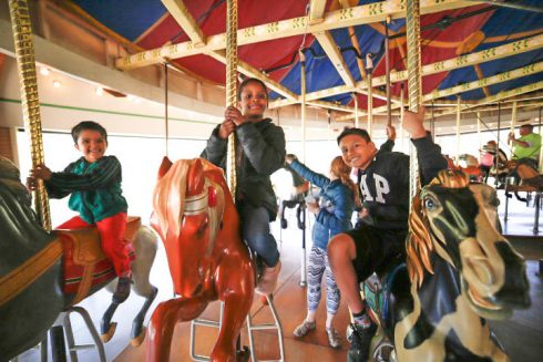 Children riding a carousel
