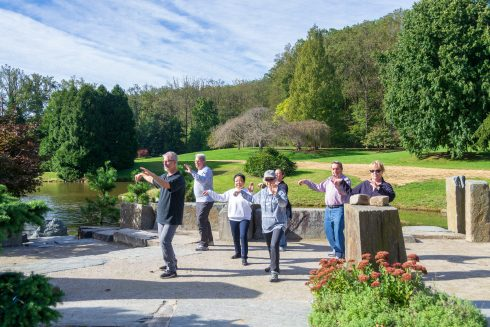 group doing tai chi in a garden