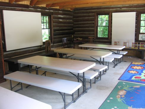 Locust Grove Nature Center Armstrong Log Cabin Interior with rows of tables