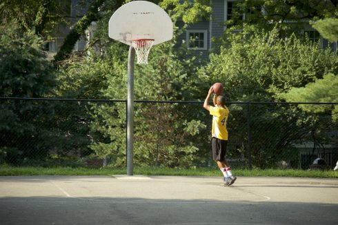 Patron playing Basketball at Chevy Chase Local Park