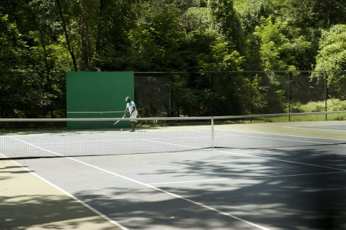 Patron playing in the Tennis court at Dale Drive Neighborhood Park