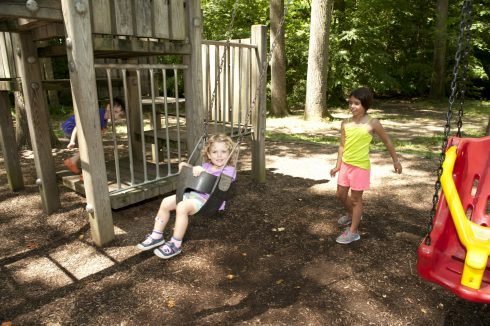 Children playing on swing set at Sligo Creek North Neighborhood Park