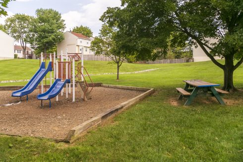A small playground and picnic table
