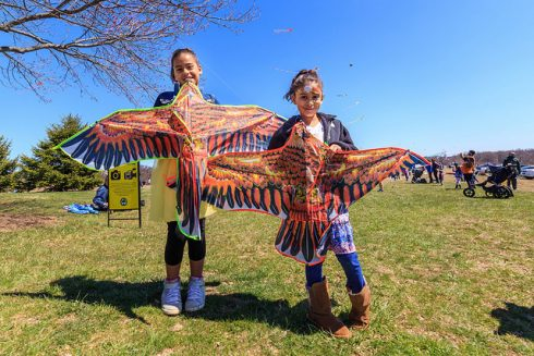 two girls holding kites