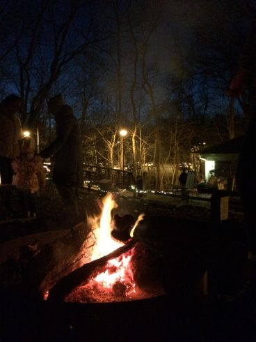 fire pit with a glowing fire after dark at Locust Grove Nature Center