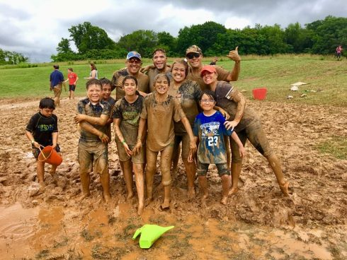 Group of people attending MudFest, standing in mud puddle, Mud, Community, Youth, Water, Fun