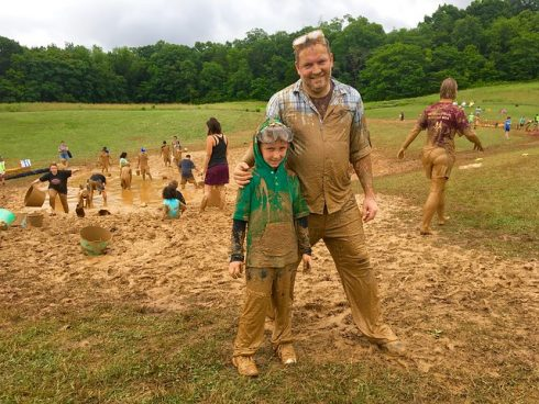 A father and son covered in mud at MudFest event, People, Mud, Fun, Child, Adaptation