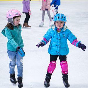 two children on ice skates
