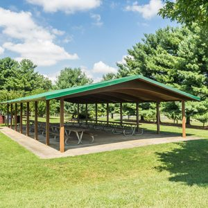 A pavilion style shelter with picnic tables
