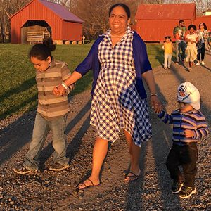 Agricultural History Farm, Mother walking with two children at farm