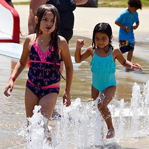 two kids playing in water