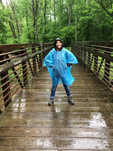 woman on a trail in a rain coat