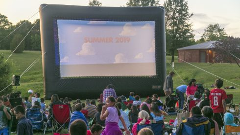 Crowd watching an outdoor movie