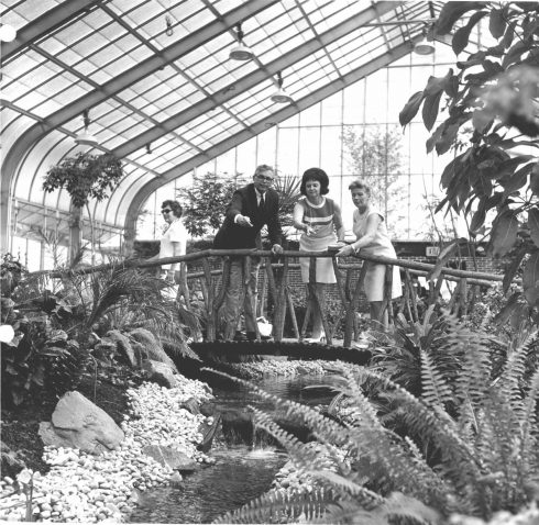 people standing on bridge in the Conservatory at Brookside Gardens