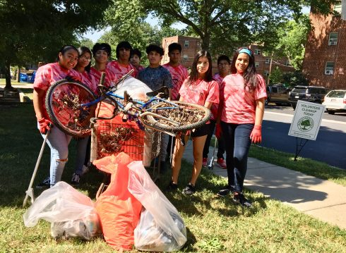 Group of young people clean up a local park