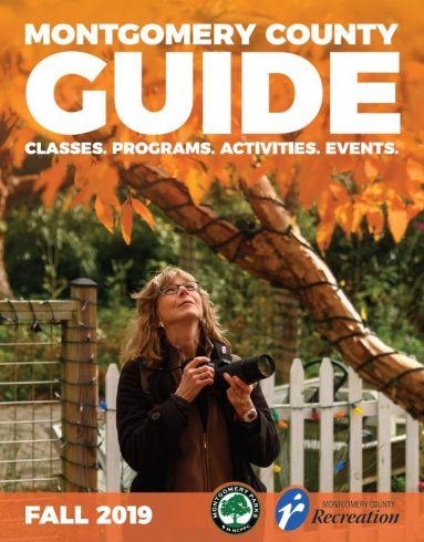 A woman looks up at a tree with a camera, Montgomery County Guide cover