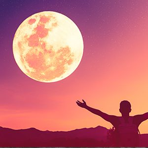 Red and Yellow Sky with Full MOon and Man in front with arms extended in happines