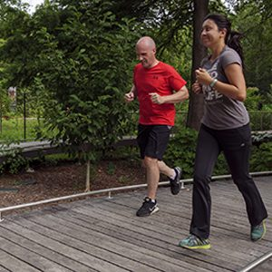 Man and woman jogging on path at Brookside Gardens