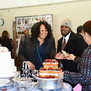 African American couple visiting with a cake baker at a vendor showcase event