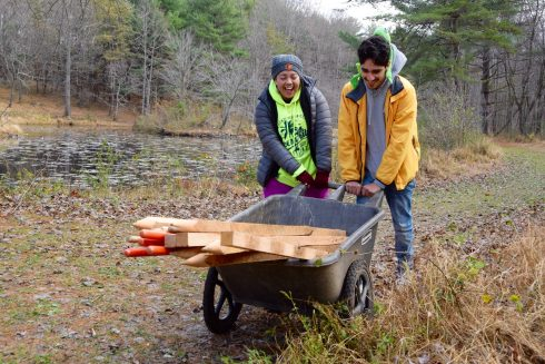 Students move wheel barrel at Maydale Conservation Park