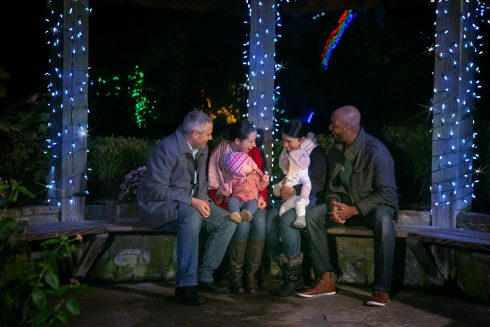 A family in a gazebo with lights
