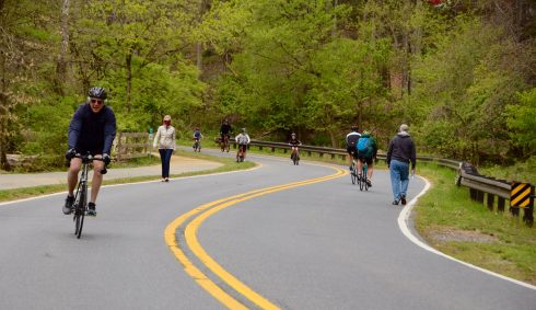 People bike and walk on a closed parkway