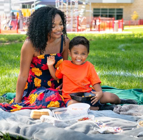 A woman and child picnicking