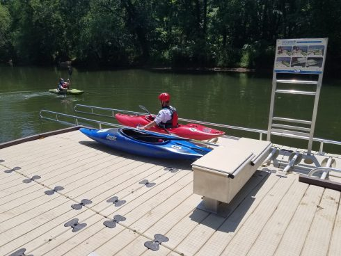 Kayaker on boat launch entering water