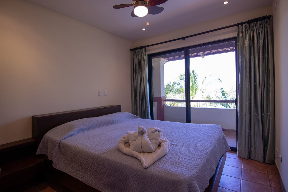 8 of 15: Master bedroom with balcony