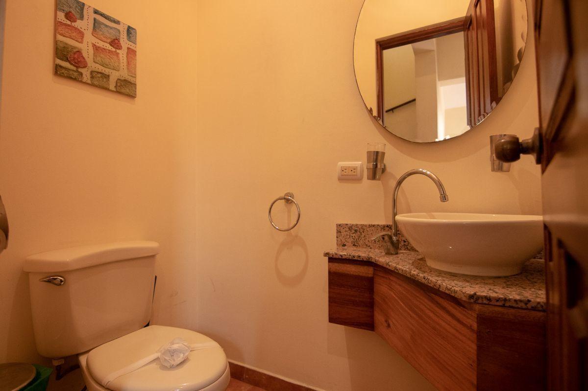 7 of 15: Downstair half bathroom