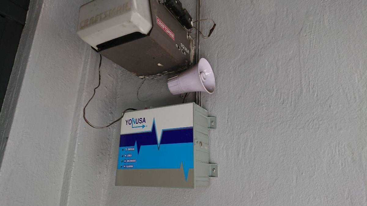 32 de 32: Sistema de alarma, cerca electrificada, cámaras