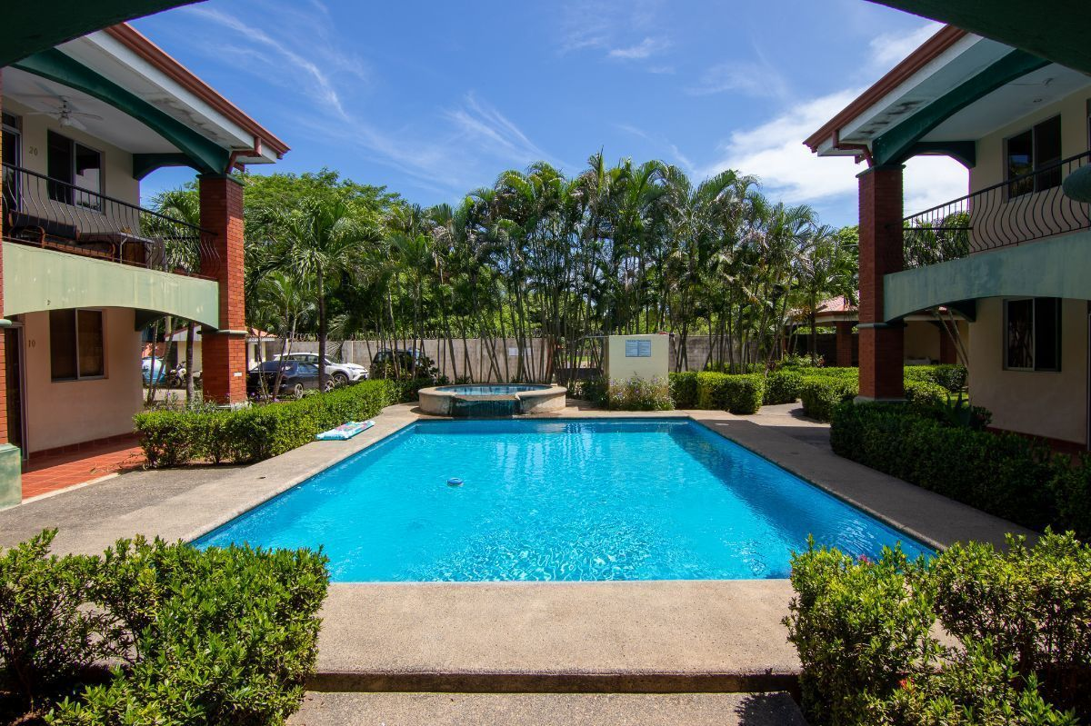 6 of 7: Community pool with jacuzzi
