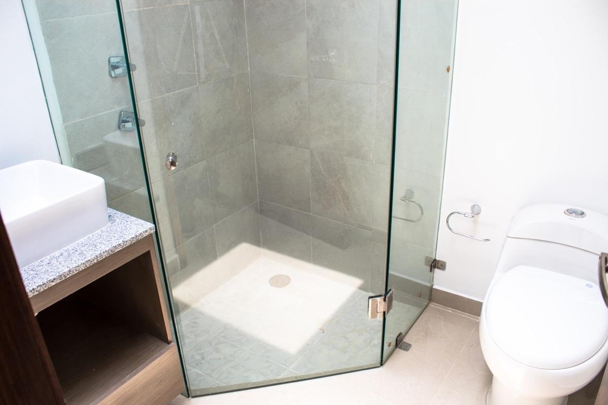 16 de 17: Baño Compartido