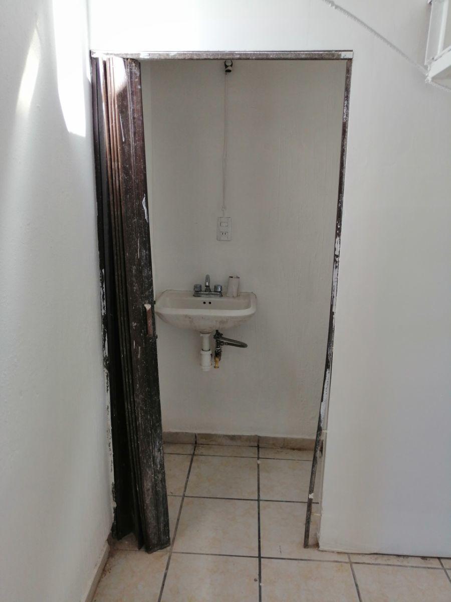 6 de 11: medio baño en planta baja
