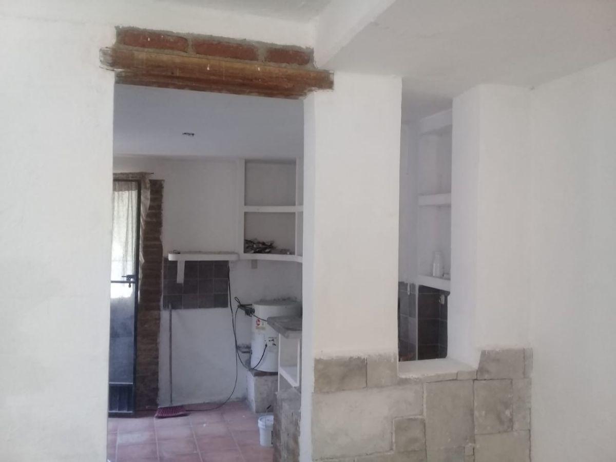5 de 11: Cocina y salida ala Recamara Planta Baja.