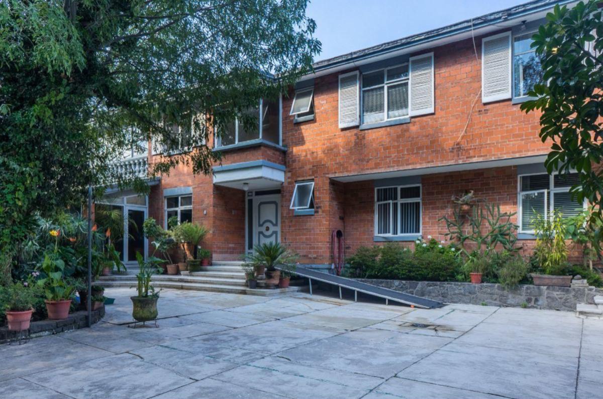 2 de 9: Fachada exterior casa