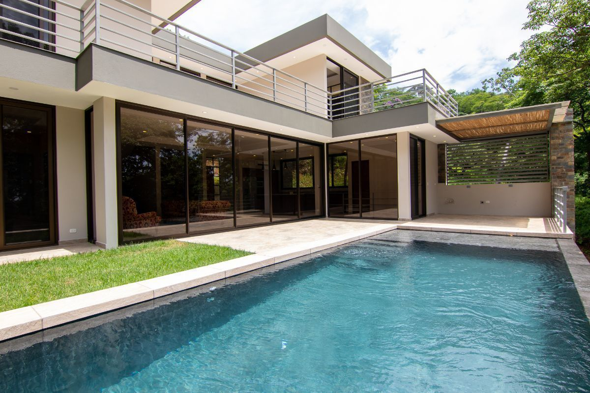 1 of 23: Front of the house with infinity pool