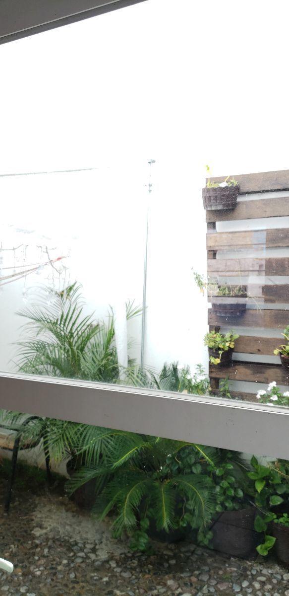 4 de 10: jardín con área de lavado