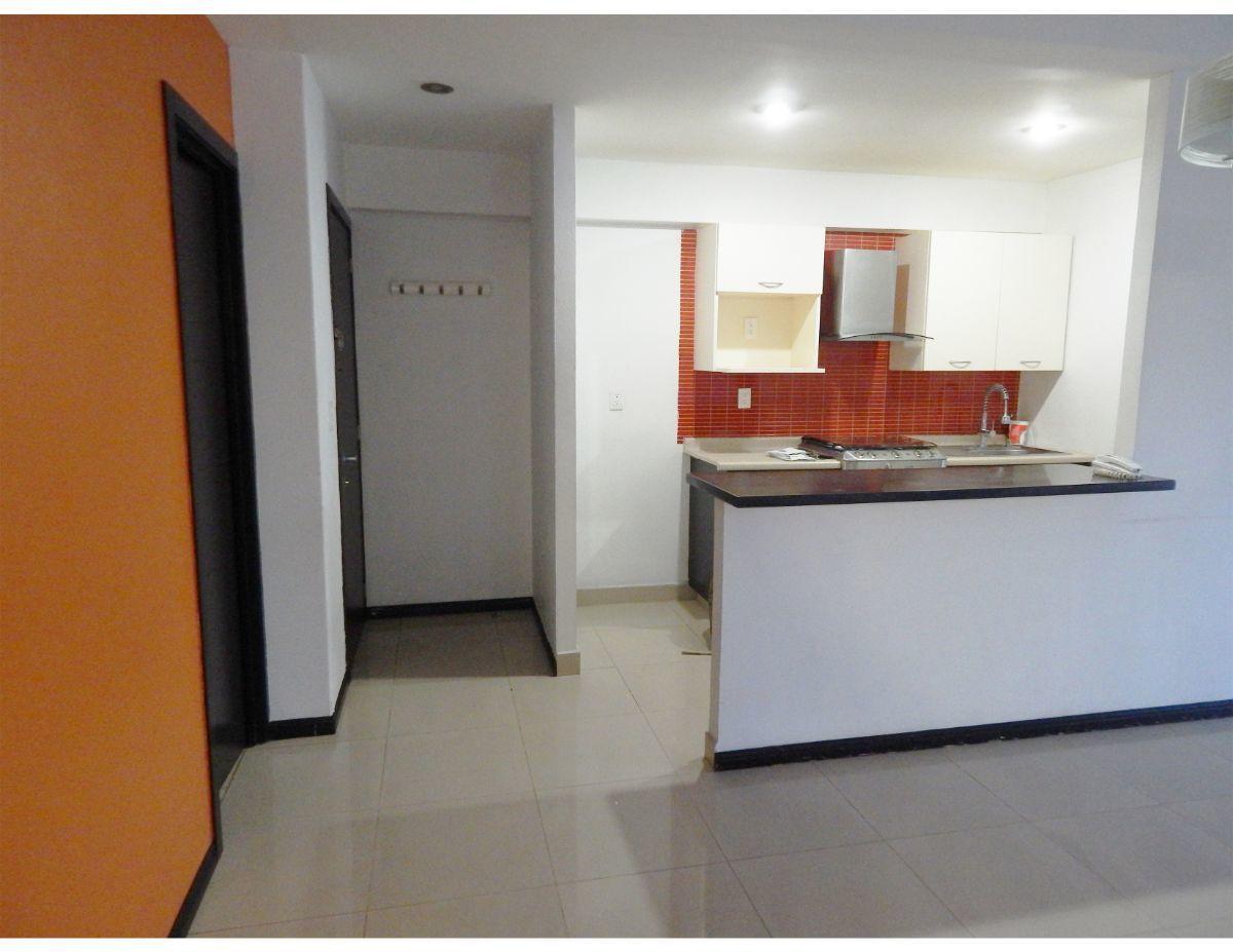 7 de 14: La cocina abierta desde la sala en el departamento