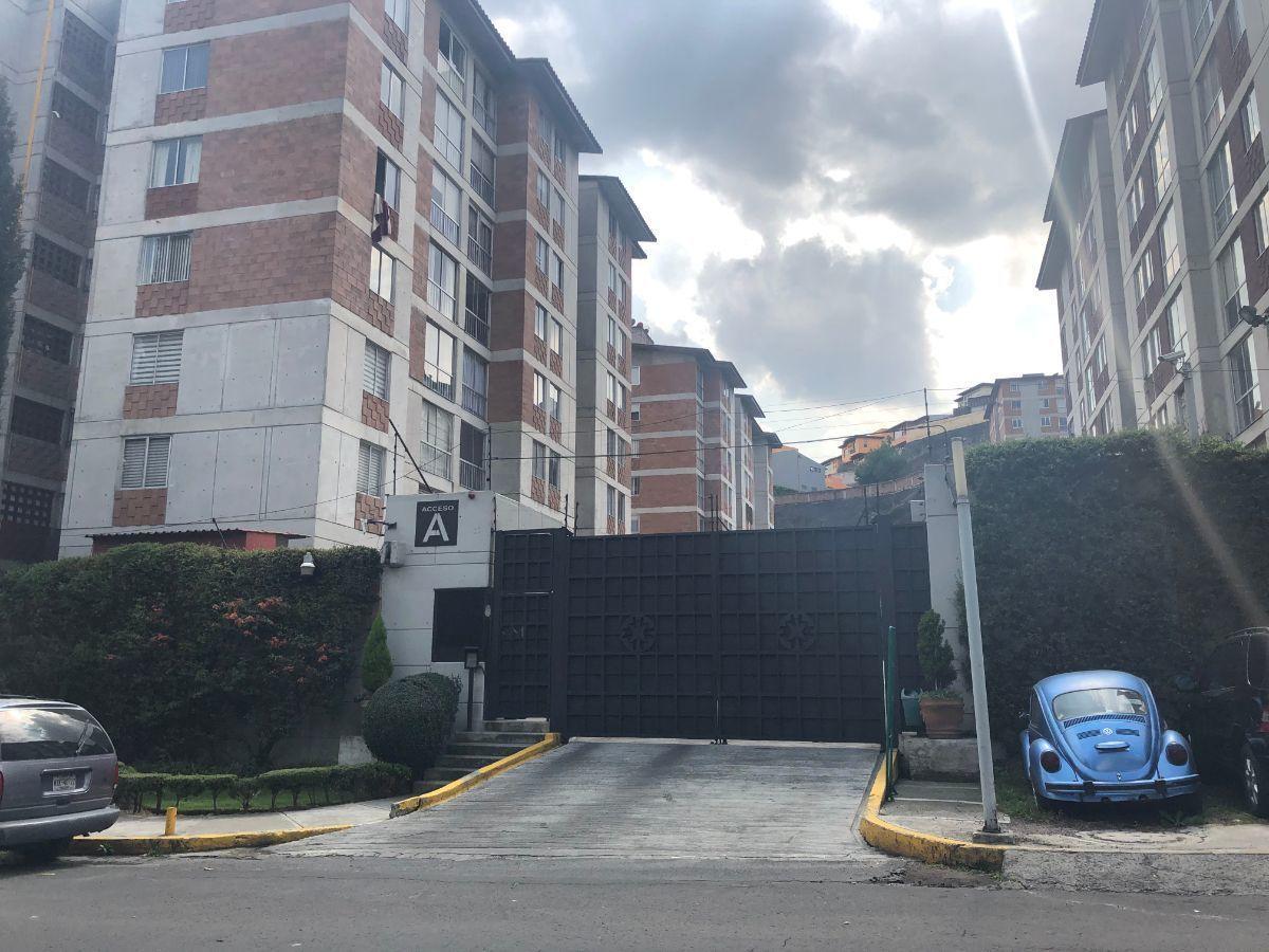 34 de 35: ENTRADA AL CONDOMINIO
