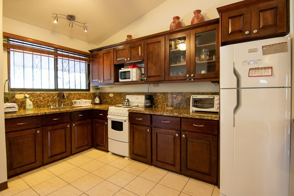 4 of 12: Living space with kitchen