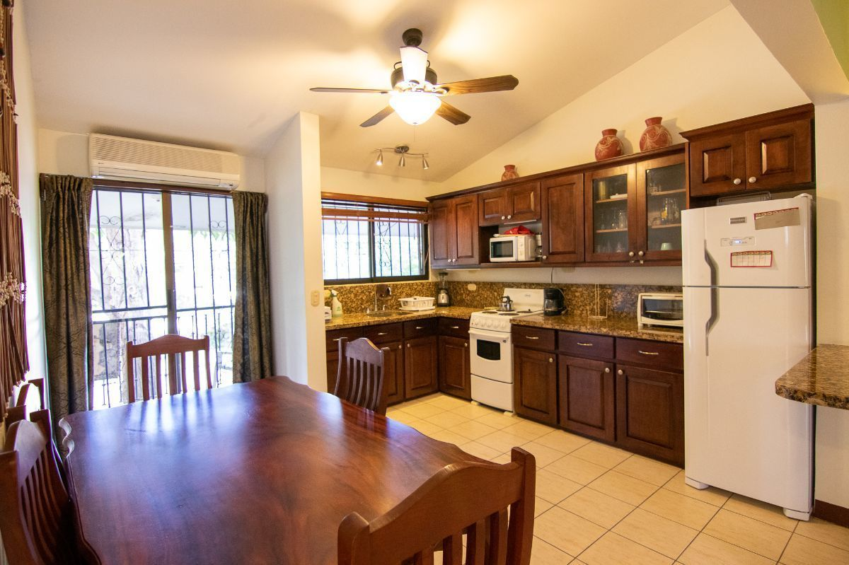 3 of 12: Living space with kitchen
