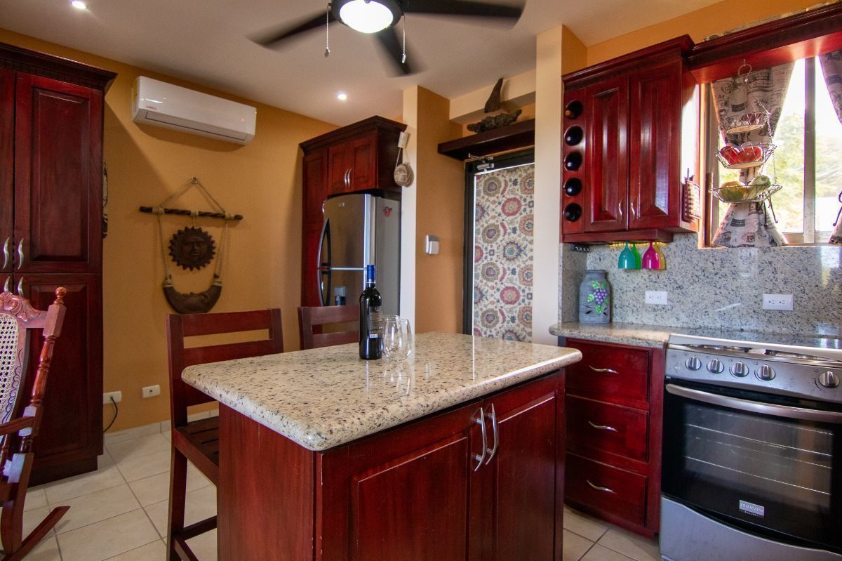 6 of 15: Living space with kitchen