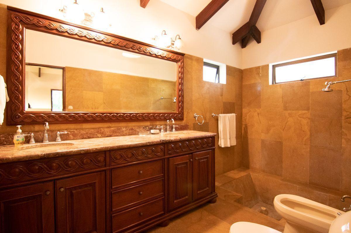 11 of 20: Master bathroom with bathtub