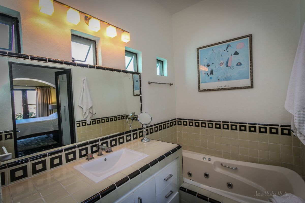 8 of 20: Master bathroom at Apt 1 with shower and massage bath tub.