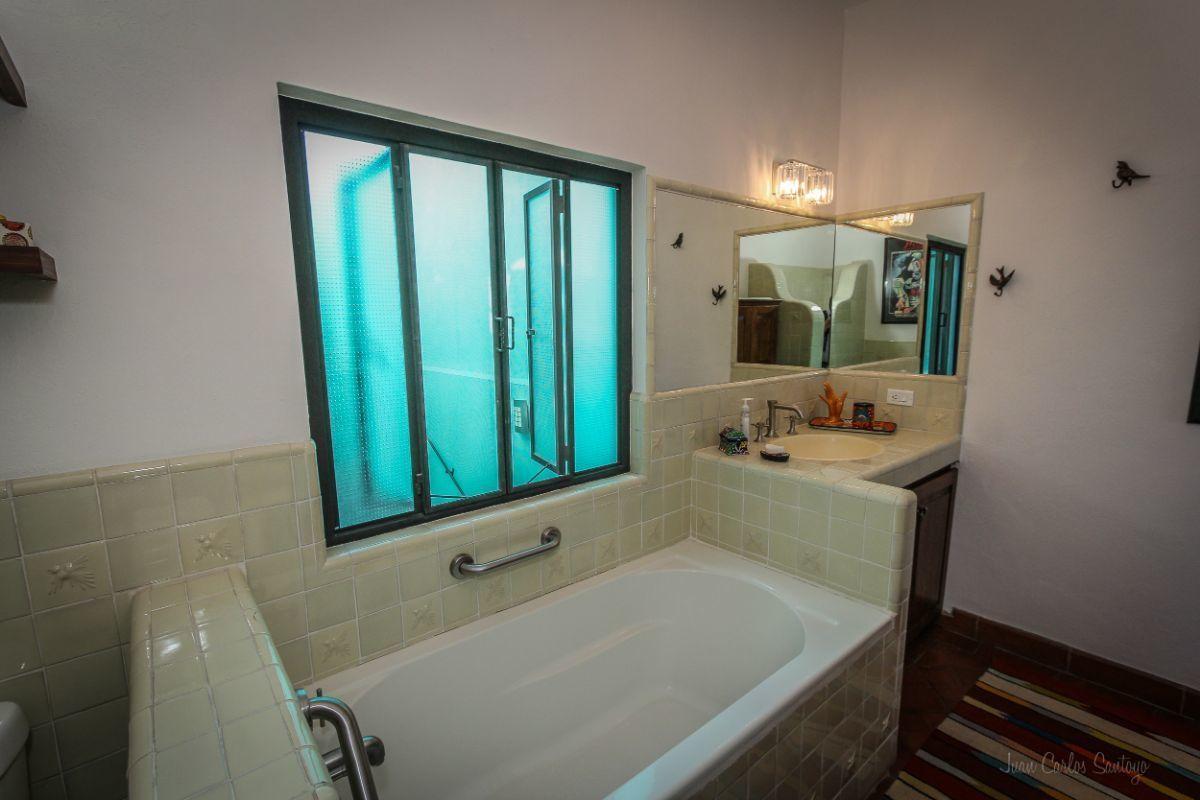 10 of 20: Master bedroom bathroon at Apt.2 with bath tub.