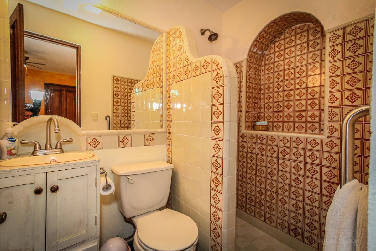 16 of 20: Tiled bathroom at Apt. 3
