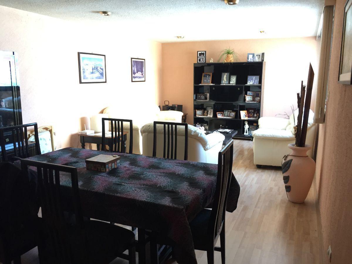 2 de 11: Área de sala comedor. Vista desde el pasillo a recámaras.