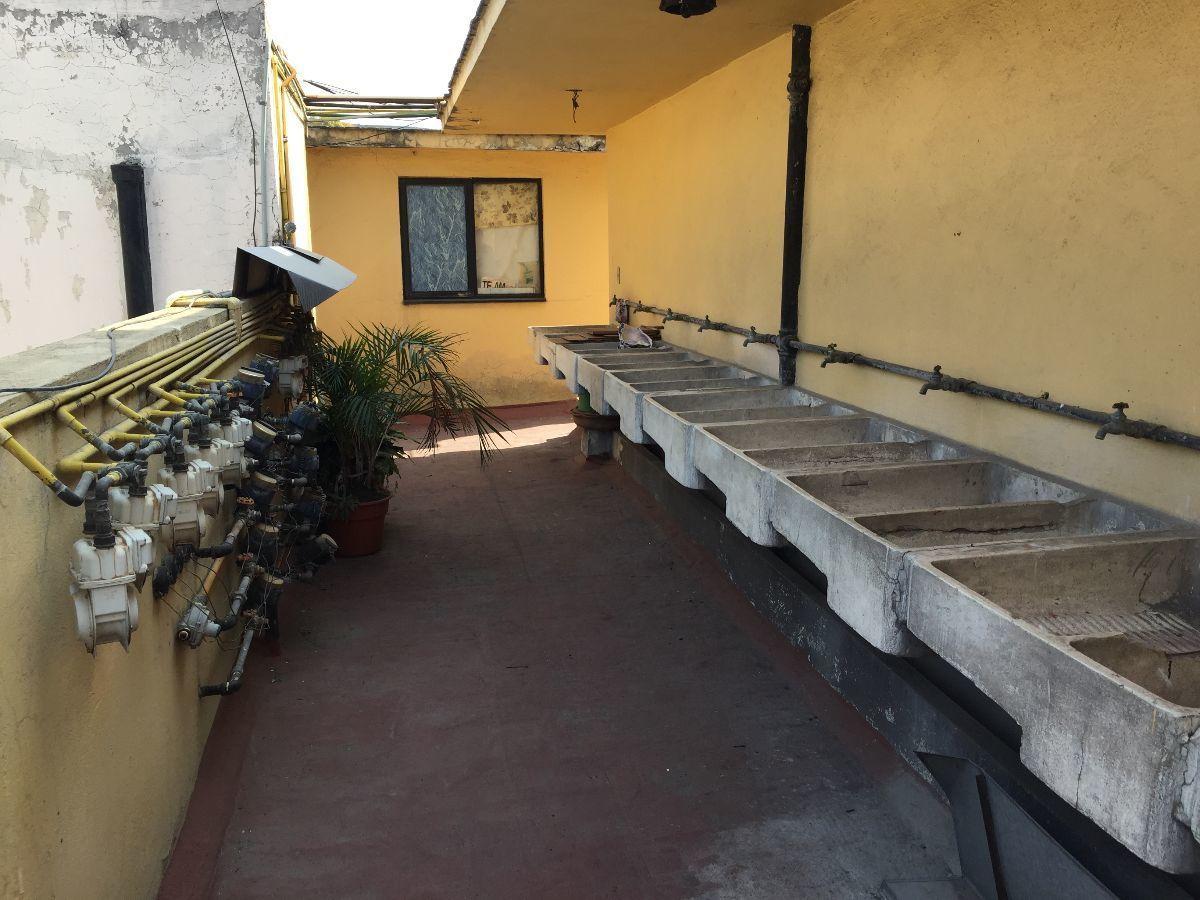9 de 11: Área de lavaderos, cuartos de servicio.