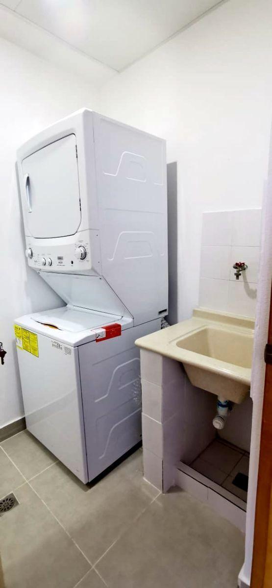 17 de 26: Lavadora secador a gas